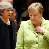 British Prime Minister Theresa May (L) and German Chancellor Angela Merkel attend the EU summit in Brussels, Belgium, on June 22.