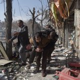 A victim being carried from the site of the bombing in Kabul, Afghanistan, on Jan. 27.  The city's hospitals were overwhelmed by the number of wounded.