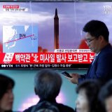 People watch a television broadcasting a news report on North Korea firing a missile that flew over Japan's northern Hokkaido far out into the Pacific Ocean, in Seoul, South Korea on September 15.