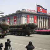 Missiles are paraded across Kim Il Sung Square during a military parade