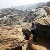 Rohingya refugees walk along the Kutupalong refugee camp in Cox's Bazar, Bangladesh, on January 21.