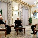 President Hassan Rouhani is flanked by Judiciary Chief Sadeq Amoli Larijani (L) and Parliament Speaker Ali Larijani in Tehran on Nov. 11.