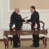 Mohammad Reza Nematzadeh (L) meets Mohammad Shiya al-Sudani in Baghdad on Feb. 14.