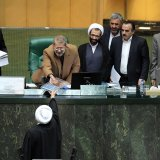 President Hassan Rouhani (foreground) presented the 10.85-quadrillion-rial ($280.6 billion) budget bill early December.