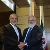 """Meeting with Iran's atomic chief Ali Akbar Salehi (L), EU Commissioner Miguel Arias-Canete echoed the block's mantra that it is """"fully committed"""" to the 2015 deal and expects the same from all other parties."""