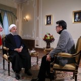 President Hassan Rouhani (L) appeared on state TV late on Jan. 23.
