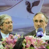 Giovanni Tramparulo (R) and Iran Air CEO Farhad Parvaresh