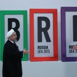 President Hassan Rouhani (L) meets Russian President Vladimir Putin at 2015 BRICS summit in Russia.