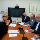 Massoud Karbasian (1st R) siting across Denmark's Minister for Development Cooperation Ulla Tørnæs  during a meeting in Washington, DC.