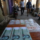 An Iraqi peddler displays Iranian currency for sale in the capital Baghdad on Aug. 9.