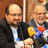 Iran's new Minister of Industries, Mining and Trade Mohammad Shariatmadari (L) and his deputy and chairman of IMIDRO, Mehdi Karbasian