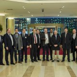 Dawood Nazirizadeh (1st L), Andreas Schmitt (3rd L) and Dr. Joe Weingarten (C) pose alongside other members of  Rhineland-Palatinate business delegation in Tehran on Feb. 5.