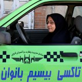 About 1,400 female chauffeurs are working with Tehran's taxi fleet.