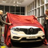 Senior Vice President of Renault Corporate Design Laurens van den Acker unveiling the company's  Koleos model in Tehran.