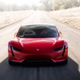 Tesla Roadster Speeds in Front of Electric Truck