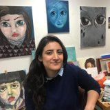 Syrian artist Lina Aljijakli with her paintings in the Atelier for Artists in Exile in Paris