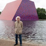 "Christo Javacheff stands in front of his ""The London Mastaba"" in Hyde Park"