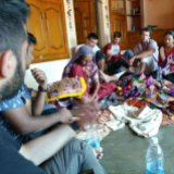 Guests watch artisans making handicrafts in a Gujarati village in India.