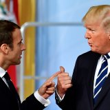 US President Donald Trump has reportedly told French President Emmanuel Macron (L) that he will look for a way to return to the Paris climate accord.
