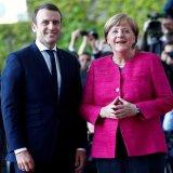 Emmanuel Macron (L) and Angela Merkel in Meseberg, Germany, Tuesday.