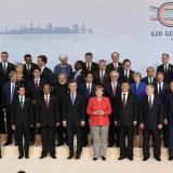 Participants pose for a group photo on the first day of the G-20 summit in Hamburg, Germany, July 7.