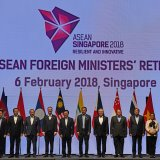 Foreign ministers pose for a group photo at the ASEAN Foreign Ministers' Meeting retreat in Singapore on February 6.