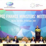 Vietnamese Prime Minister Nguyen Xuan Phuc (rear) speaks at the 24th APEC Finance Ministers' Meeting in Hoi An, Quang Nam Province, in central Vietnam, on Oct. 21.