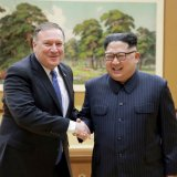 Kim Jong-un (R) receives Mike Pompeo in Pyong Yang on May 9.