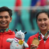 Indonesian mixed double Christopher Rungkat (L) and Aldila Sutjiadi took the gold medal at in the mixed tennis double of the 2018 Asian Games in Palembang on Saturday.