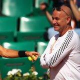 Andre Agassi (R) and Novak Djokovic