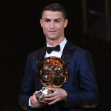 Cris Ronaldo holding his fifth Ballon d'Or