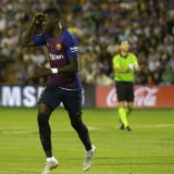 Ousmane Dembele (L) powers Barca past promoted Valladolid for second straight win.