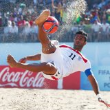 Mohammad Ahmadzadeh scores a goal with a bicycle kick during the FIFA Beach Soccer World Cup Portugal 2015 Group C match between Iran and Brazil.