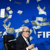 """Sepp Blatter was showered with fake money by British comedian Lee Nelson at 2015 FIFA press conference, Zurich. """"Sepp, this is for North Korea in 2026"""" said Nelson while throwing money to blatter, accusing him of bribery in FIFA."""