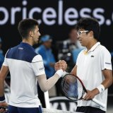 Novak Djokovic (L) and Chung Hyeon