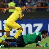 Baghdad Bounedjah in action with Esteghlal players