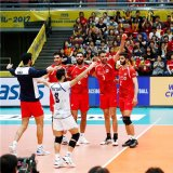 Iran players rejoice after defeating France and taking a bronze medal.
