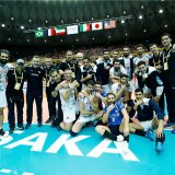 Iranian players and coaches celebrate the victory over Japan.