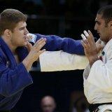 Javad Mahjoub (R) against Hun Cirjenics at  the 2016 Almaty Grand Prix in Kazakhstan