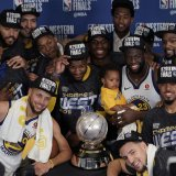 The Golden State Warriors pose with their trophy.
