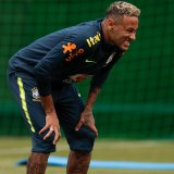 Brazil's star forward Neymar limped off during a training session on Tuesday.