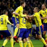 Swedes celebrate their winning goal against Italy.