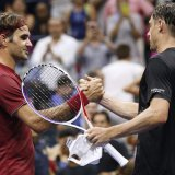 Roger Federer (L) lost to John Millman in the fourth  round of US Open.