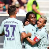 Bayern Munich Renato Sanches (C) celebrates after scoring his side's second goal.