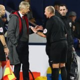 Arsene Wenger has words with Dean at the Hawthorns