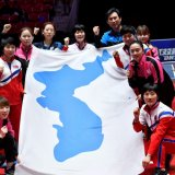 Korean players hold the unified  flag at the tournament.
