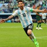 Lionel Messi celebrates scoring his teams's first goal against Nigeria.
