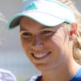 Dane Humbles Williams to Claim WTA Crown