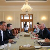 Deputy Foreign Minister Abbas Araqchi (2nd L) meets with British Junior Foreign Minister Alistair Burt (3rd R) in Tehran on Saturday.