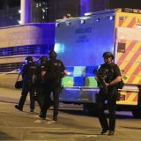 Armed police work after an explosion at the Manchester Arena in Manchester, England, on May 23.